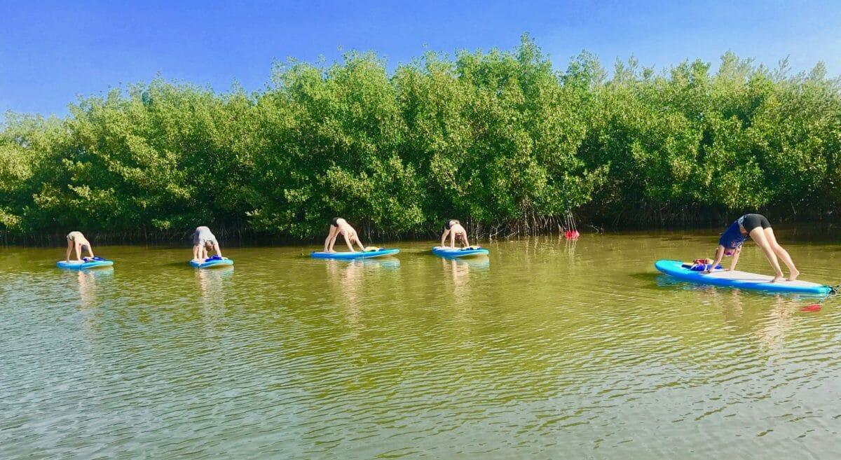 SoBe Surf Paddle SUP Yoga Class Paddle Board Yoga Merritt Island Cocoa Beach Florida