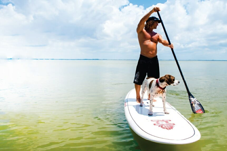 Girard Middleton and dog Kona stand up paddle boarding