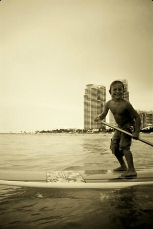 Kids stand up paddle in Miami