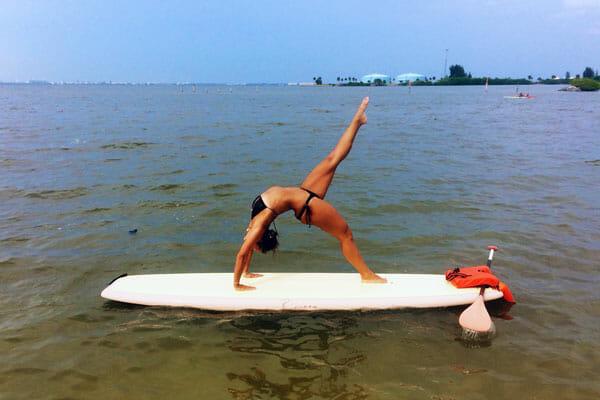 SUP yoga instructor in Cocoa Beach, FL