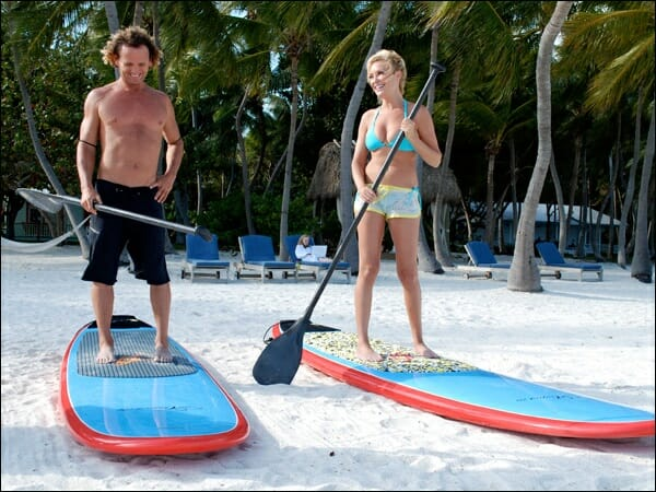 Girard Middleton teaching Bridget how to SUP on the Travel Channel's Bridget's Sexiest Beaches 2008