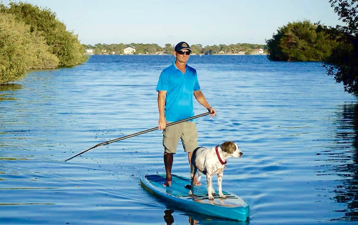 "Girard Middleton of SoBe Surf on a Riviera Paddlesurf Voyager Classic SUP Stand up Touring Board 12'6"" dog Kona"